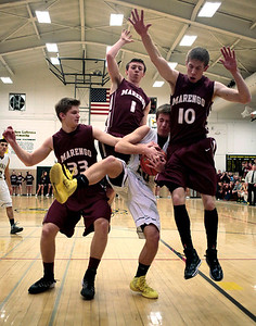 Kyle Grillot - kgrillot@shawmedia.com  Harvard seniors Zach Martin (20) tries to get through the defense of Marengo senior Adam Rogutich (33), junior Koty Kissack (1) and Max Kunde (10) during the second quarter of the boys basketball game of the Castle Challenge Friday in Harvard. Marengo beat Harvard 54-45.