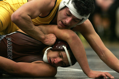 Kyle Grillot - kgrillot@shawmedia.com  Harvard's Jose Meija wrestles Marengo's Brandon Dierkes during the 170-pound match of the Castle Challenge Friday in Harvard. Harvard won the meet, 50-24.