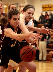 Kyle Grillot - kgrillot@shawmedia.com  Harvard senior Abby Linhart right and Marengo junior Rachel Tautges (2) fight for a lose ball during the first quarter of the girls basketball game Friday in Harvard. Harvard beat Marengo 43-41.