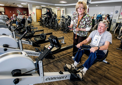 "Sarah Nader- snader@shawmedia.com Janeen Jackewicz (left), a registered nurse in Cardiac Rehab at Centegra Health Systems monitors Harry ""Duke"" Burmann's heart during his cardiac rehab appointment in McHenry Friday, January 31, 2014. Burmann was Centegra Health System's 1,000th cardiac surgery last October."