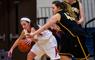 Kyle Grillot - kgrillot@shawmedia.com   Jacobs senior Nicole Cook (43)  goes attempts to steal the ball from Marian Central junior Sarah Benigni during the first quarter of the girls basketball game Thursday in Woodstock. Jacobs beat Marian Central, 56-48. 1