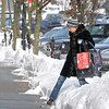 Lennie Fenton, of Naperville, steps through plowed snow to the sidewalk in downtown Hinsdale on Wednesday, Jan. 8, 2014. With the temperature reaching a balmy positive 13 degrees, people are out and about. (Bill Ackerman photo)