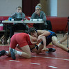 St. Charles North's Conrad Noverini (Right) locks up with Naperville Central's Nick Nunziato during their 132 match at Naperville Central High School in Naperville, IL on Friday, January 02, 2015 (Sean King for Shaw Media)