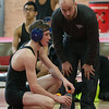 St Charles North's Steve Collins (Left) talks to his coach Ben Hummel during a break in action against Naperville Central's Ben Williamson in their 138 match at Naperville Central High School in Naperville, IL on Friday, January 02, 2015 (Sean King for Shaw Media)