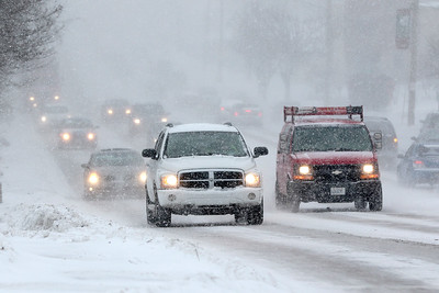 Kyle Grillot - kgrillot@shawmedia.com  Motorists travel through heavy blowing snow along Northwest Highway Thursday, January 8, 2015 in Fox River Grove. The National Weather Service has issued a winter weather advisory in effect until 3 a.m. Thursday morning. The strong winds could result in considerable blowing and drifting snow, leading to white out conditions in MCHenry County.