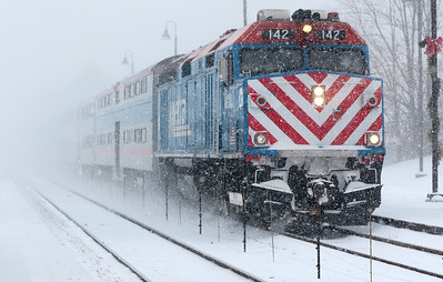 Kyle Grillot - kgrillot@shawmedia.com  An outbound Metra train approaches the Fox River Grove Station Thursday, January 8, 2015. The National Weather Service has issued a winter weather advisory in effect until 3 a.m. Thursday morning. The strong winds could result in considerable blowing and drifting snow, leading to white out conditions in MCHenry County.