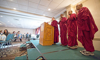 John Konstantaras - For Shaw Media Monks from the Blue Lotus Buddhist Temple in Woodstock (L-R) BhanteSumana, Bhante Dhammadassi, Bhante Amitha and Bhikkhuni Vimala chant during a meditation session in the closing of the FaithBridge Fifth Annual 2015 Martin Luther King Jr. Interfaith Prayer Breakfast at D'Andrea Banquets on Monday January 19, 2015 in Crystal Lake, Ill.