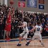 Aurora Christian's Pat McNamara (4) shoots a three pointer over St. Francis guard Gabriel Johnson (22) at St. Francis High School in Wheaton, IL on Friday, January 23, 2015 (Sean King for Shaw Media)