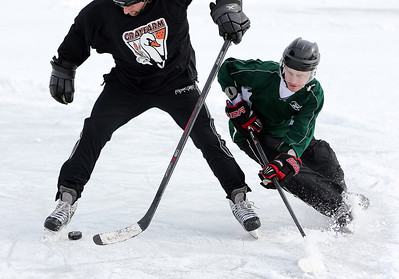 Kyle Grillot - kgrillot@shawmedia.com  Matt Morgan of Elgin (left) tries to out skate Dan DelVecchio of West Dundee as he heads towards the goal during their match in the annual Pond Hockey tournament Saturday, January 31, 2015 at Woods Creek Lake in Lake in the Hills. All games have two 15 minute halves with a 2 minute halftime. Each team is guaranteed two games.