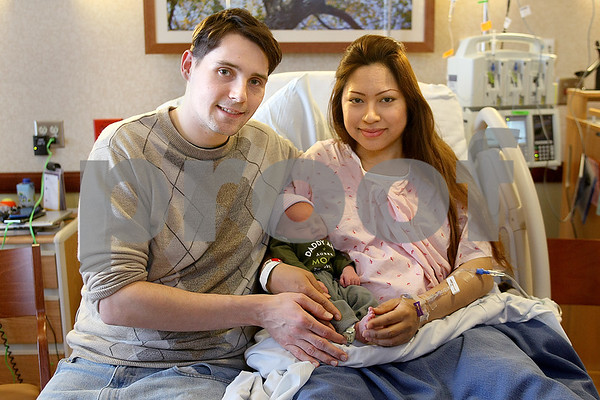 Katie Smith – ksmith@shawmedia.com<br /> New parents Matt Kacskos and Anne Meesriyong-Kascos Friday hold their son, the first baby to be born in DeKalb County in 2016. The baby was 7 pounds, 7 ounces and 20 inches long. Meesriyong-Kascos went through 56 hours of labor to deliver her baby.