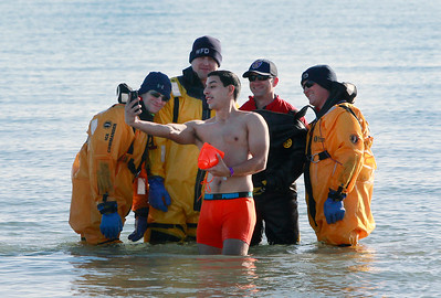 Candace H. Johnson-For Shaw Media Eric Bonilla, 21, of Waukegan takes a selfie with Waukegan firefighters John DiNicola, Jeff Koch, Steve Mudrak and Matt Sheahan in Lake Michigan during the Polar Bear Plunge at Waukegan Municipal Beach.