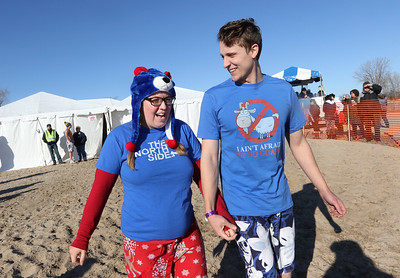 Candace H. Johnson-For Shaw Media Emily and Brendan Alviani, of Kenosha, Wis., get ready to run into Lake Michigan during the 18th Annual Polar Bear Plunge at Waukegan Municipal Beach.