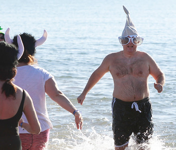Candace H. Johnson-For Shaw Media Lance Nalezny, 59, of Mundelein runs through Lake Michigan during the 18th Annual Polar Bear Plunge at Waukegan Municipal Beach.