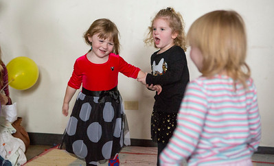"Mike Greene - For Shaw Media  Olivia Jacoby, left, 3 of Island Lake, and Mirabelle Renje, 3 of Crystal Lake play on the ""bubble stomp"" during a ""Noon Year's Eve Party Saturday, December 31, 2016 at Village Hall in Lake in the Hills. The event included crafting party hats and noise makers, ""snowball toss"" and other games before welcoming in the ""noon"" year with a balloon drop."