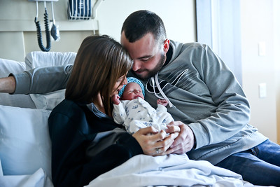 Michelle LaVigne/ For Shaw Media Karel and Greg Roth of Wonder Lake hold their son, Korben, the first baby of the new year on Sunday, January 1, 2017 at  Centegra Hospital-Huntly in Huntley. Koran was born at 5:34 a.m.