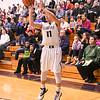 Kaneland's Kyle Stuart spots up for a 3-point shot on Dec. 27 during a game against Yorkville at the Plano Christmas Classic. Stuart made a pair of 3-pointers in the tournament as the Knights went 1-3 and placed 10th.