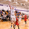 Jake Hed of Kaneland goes up for a layup on Dec. 27 during a game against Yorkville at the Plano Christmas Classic tournament. Hed averaged 5.3 points per game as Kaneland went 1-3 at the tourney.