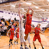 Kaneland's Daniel Franck goes up for a layup on Dec. 27 during the Knights' game against Yorkville at the Plano Christmas Classic. Franck scored six points per game to be Kaneland's second-leading scorer at the tournament.