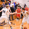 Kaneland's Daniel Franck (left) and Kyle Stuart slap five on Dec. 27 during a game against Yorkville at the Plano Christmas Classic tournament. The Knights won against Yorkville and went 1-3 to finish in 10th place in the 24-team tournament.