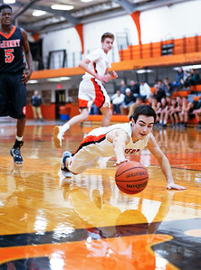 Collin Freund (1) from Crystal Lake Central dives for a loose ball during the second quarter of their game against McHenry at Crystal Lake Central High School on Saturday, January 7, 2017 in Crystal Lake, Ill. The Warriors defeated the Tigers 54-39.  John Konstantaras photo for the Northwest Herald