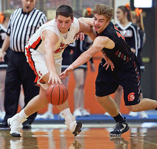 Patrick Breisch (15) from McHenry steals the ball from Alex Timmerman (55) from Crystal Lake Central during the third quarter of their game at Crystal Lake Central High School on Saturday, January 7, 2017 in Crystal Lake, Ill. The Warriors defeated the Tigers 54-39.  John Konstantaras photo for the Northwest Herald