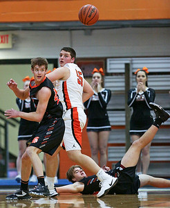 Brian March (40) from McHenry and Alex Timmerman (55) from Crystal Lake Central keep an eye on a loose ball during the third quarter of their game at Crystal Lake Central High School on Saturday, January 7, 2017 in Crystal Lake, Ill. The Warriors defeated the Tigers 54-39.  John Konstantaras photo for the Northwest Herald