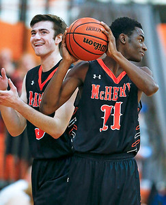 Maki Mohr (11) and Gavin Markgraff (left) from McHenry celebrate as time runs out in the fourth quarter of their game at Crystal Lake Central High School on Saturday, January 7, 2017 in Crystal Lake, Ill. The Warriors defeated the Tigers 54-39.  John Konstantaras photo for the Northwest Herald