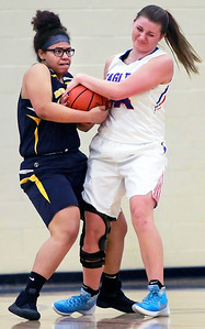 Candace H. Johnson-For Shaw Media Round Lake's Hannah Brooks and Lakes Natalie Pawlak fight for the ball in the fourth quarter at Lakes Community High School in Lake Villa.