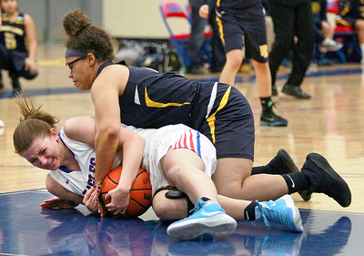 Candace H. Johnson-For Shaw Media Lakes Natalie Pawlak and Round Lake's Hannah Brooks fight for the ball in the second quarter at Lakes Community High School in Lake Villa.
