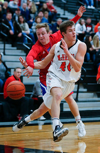 Sean Jay (1) from Dundee-Crown knock the ball away from Brian March (40) from McHenry during the second quarter of their game at McHenry High School on Wednesday, January 11, 2017 in McHenry. The Warriors defeated the Chargers 41-39 in overtime. John Konstantaras photo for the Northwest Herald