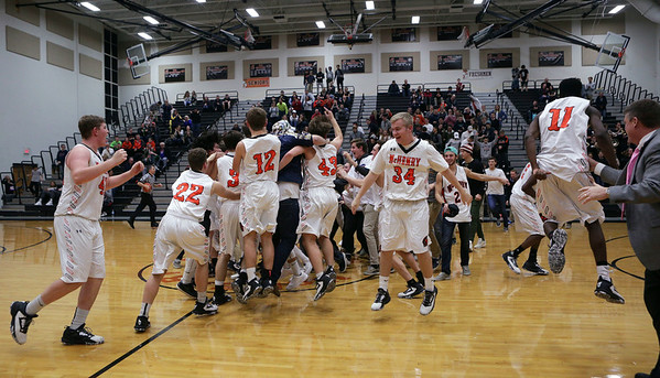 McHenry players and fans celebrate their 41-39 overtime win against Dundee-Crown at McHenry High School on Wednesday, January 11, 2017 in McHenry.  John Konstantaras photo for the Northwest Herald