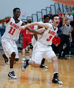 Maki Mohr (11) and Gavin Markgraff (3) from McHenry celebrate after beating Dundee-Crown in overtime of their game at McHenry High School on Wednesday, January 11, 2017 in McHenry. The Warriors defeated the Chargers 41-39. John Konstantaras photo for the Northwest Herald
