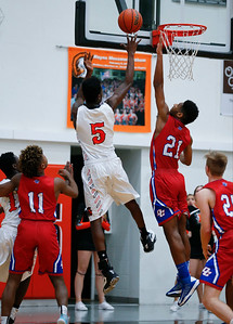 Matthew Mohr (5) from McHenry sinks the game winning basket over Tariq Burns (21) from Dundee-Crown during overtime of their game at McHenry High School on Wednesday, January 11, 2017 in McHenry. The Warriors defeated the Chargers 41-39. John Konstantaras photo for the Northwest Herald