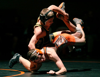 Jacobs' Justin Peters breaks down McHenry's Matt Gutierrez in their 106-lb match during their dual wrestling meet at McHenry High School East on Wednesday, January 12, 2017 in McHenry, Ill. Peters defeated Gutierrez. John Konstantaras photo for the Northwest Herald