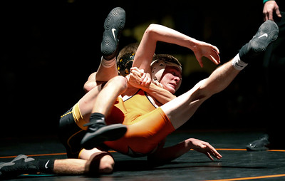 Lucas Busse from McHenry fights off back points by Beau Harrier  from Jacobs in their 120-lb match during their dual wrestling meet at McHenry High School East on Wednesday, January 12, 2017 in McHenry, Ill. Buses defeated Harrier 3-0. John Konstantaras photo for the Northwest Herald