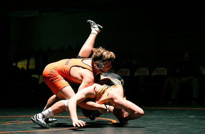 McHenry's Jaden Glauser takes down Jacobs' Reese Wiggins in the first period of their their 170-lb match during their dual wrestling meet at McHenry High School East on Wednesday, January 12, 2017 in McHenry, Ill. Glauser defeated Wiggins by a technical fall. John Konstantaras photo for the Northwest Herald