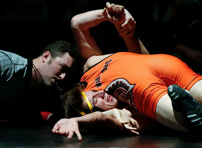 Jacobs' Anton Zange fights off a pin as McHenry's Andrew Hertel-Pence scores back points on during their 138-lb match at McHenry High School East on Wednesday, January 12, 2017 in McHenry, Ill. Hertel-Pence defeated Zangle. John Konstantaras photo for the Northwest Herald