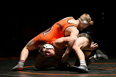 Jacobs' David Dudych (bottom) fights off a takedown by McHenry's Dominic Rossier in the first period of their 152-lb match during their dual wrestling meet at McHenry High School East on Wednesday, January 12, 2017 in McHenry, Ill. Dudych defeated Rossier 18-8. John Konstantaras photo for the Northwest Herald