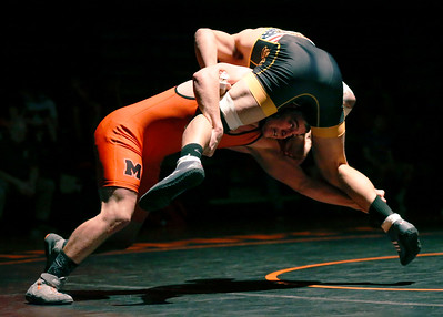 Jacobs' Loren Strickland fights off a double leg takedown shot by McHenry's Jake Leske in their 182-lb match during their dual wrestling meet at McHenry High School East on Wednesday, January 12, 2017 in McHenry, Ill. Strickland won the match. John Konstantaras photo for the Northwest Herald