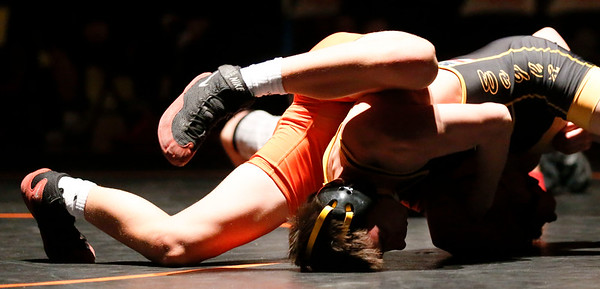 Jacob's Johnny Ridle (right) scores back points on McHenry's Will Conlon during their 126-lb match at McHenry High School East on Wednesday, January 12, 2017 in McHenry, Ill. Ridle pinned Conlon. John Konstantaras photo for the Northwest Herald