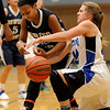 Geneva's Brie Borkowicz (right) pulls the ball away from Oswego East's Jisinde Thomas (left) during a girls varsity basketball game the 27th annual Subway Classic at Willowbrook High School in Villa Park on Jan. 14.
