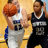 Geneva's Stephanie Hart (42) takes the ball to the hoop against Oswego East defender Amaya Johns (30) during a girls varsity basketball game the 27th annual Subway Classic at Willowbrook High School in Villa Park on Jan. 14.