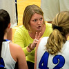 Geneva head coach Sarah Meadows uses a timeout to redirect her players during a girls varsity basketball game against Oswego East at the 27th annual Subway Classic at Willowbrook High School in Villa Park on Jan. 14.