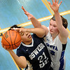 Oswego East's Jada Boatright (21) puts up a shot against Geneva defender Madison Mallory (33) during a girls varsity basketball game the 27th annual Subway Classic at Willowbrook High School in Villa Park on Jan. 14