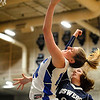 Geneva's Grace Loberg (10) puts up a tough layup against Oswego East defender Sydney Schultz (32) during a girls varsity basketball game the 27th annual Subway Classic at Willowbrook High School in Villa Park on Jan. 14.