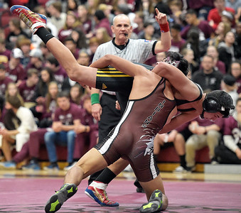 Kayla Wolf - For the Northwest Herald Marengo senior Michael Vega-Perez takes down Harvard freshman Ahmad Sheikhali (cq) at Marengo on Saturday, Jan. 28, 2017. Although Harvard High School won the meet, Vega-Perez won his matchup against Sheikhali.