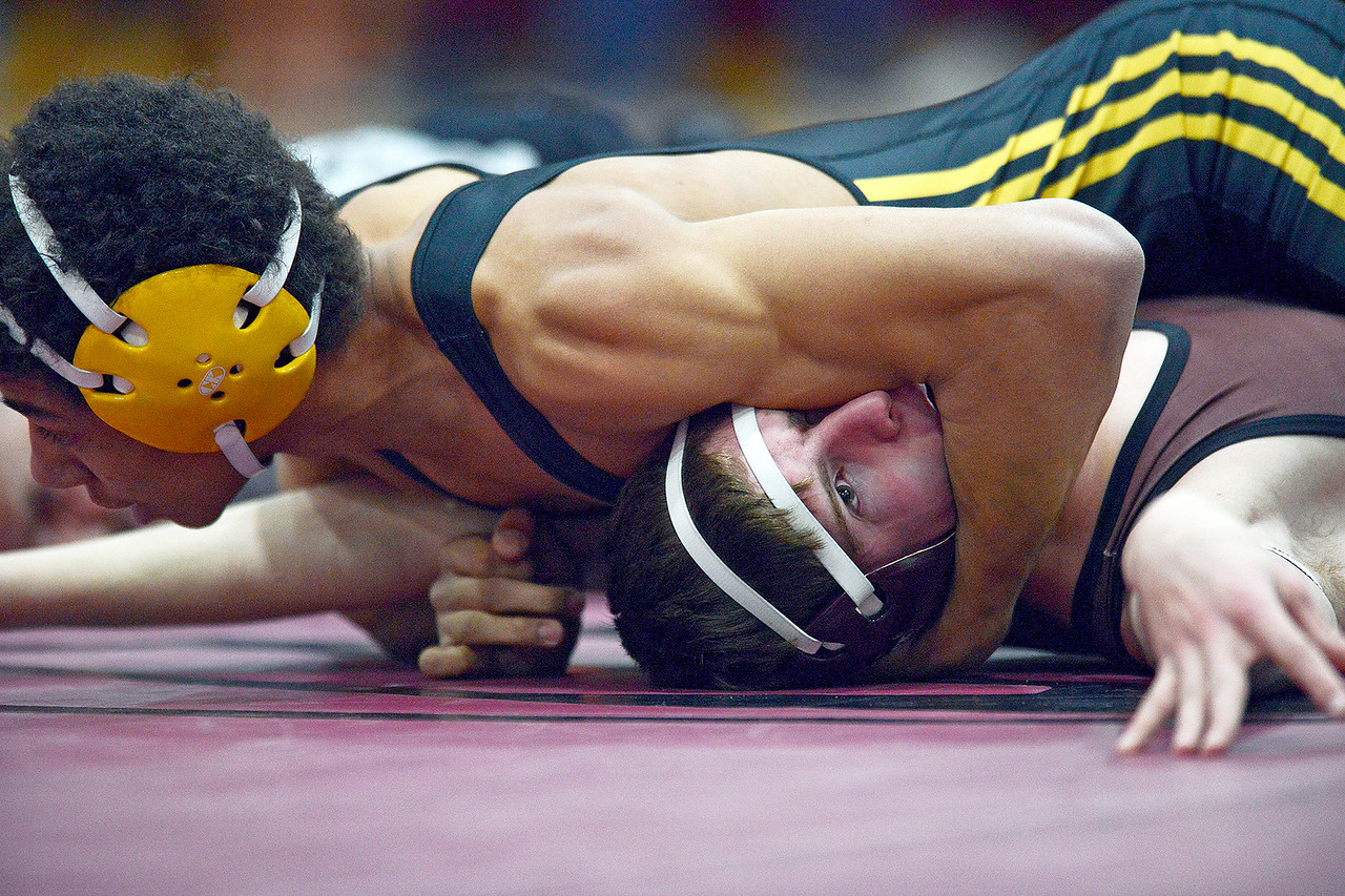 Kayla Wolf - For the Northwest Herald Harvard junior Keenan Brummett takes on Marengo Cameron Miller at a dual meet for the Kishwakee River Conference title Saturday, Jan. 28, 2017. Brummett won his match.