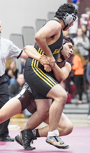 Kayla Wolf - For the Northwest Herald Marengo senior Aaron Recendiz(cq) grabs Harvard junior Francisco Quinones by the waist for a takedown during a meet at Marengo High School on Saturday, Jan. 28, 2017. Harvard won the meet and secured the Kishwakee River Conference title.