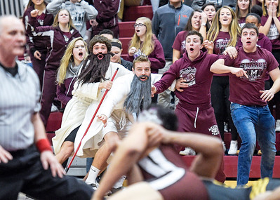 Kayla Wolf - For the Northwest Herald The Marengo student section cheers as senior Aaron Recendiz scores a point for taking down Harvard junior Francisco Quinones.  Harvard won the meet in addition to the Kishwaukee River Conference title.