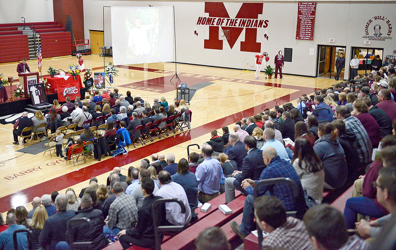 Kayla Wolf - For Shaw Media Family, friends and community members filled the gymnasium at Marengo Community High School of a celebration of life ceremony for Derek Caskey, a former Marengo football player on Sunday, January 29, 2017. Family, friends and coaches spoke and shared stories of Derek's life.